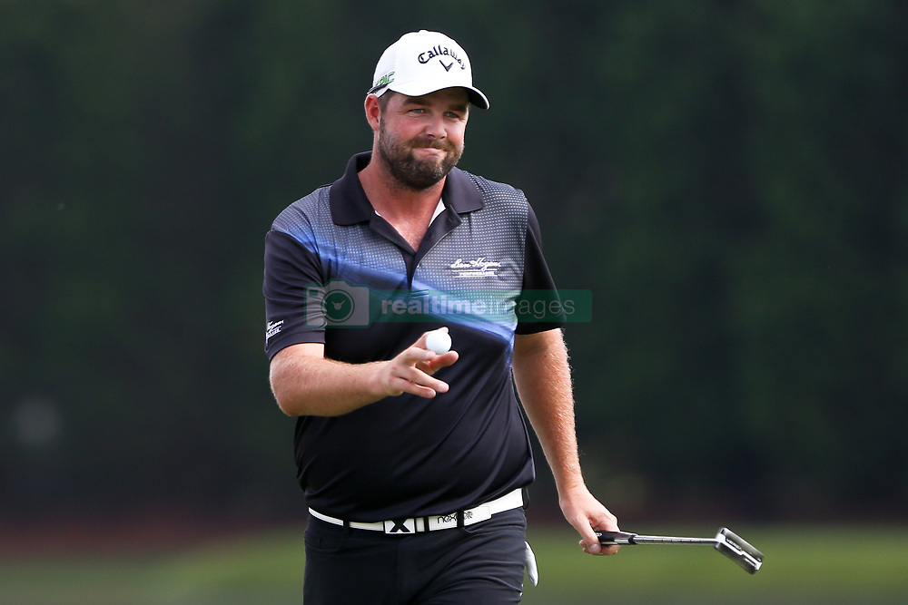 September 22, 2017 - Atlanta, Georgia, United States - Marc Leishman waves to the crowd after putting the 15th green during the second round of the TOUR Championship at the East Lake Club. (Credit Image: © Debby Wong via ZUMA Wire)