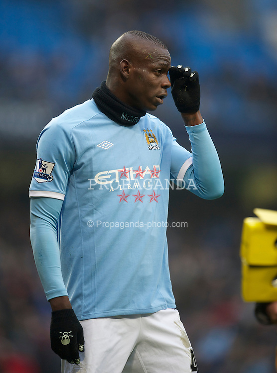 MANCHESTER, ENGLAND - Sunday, February 20, 2011: Manchester City's Mario Balotelli is treated for a head injured during the FA Cup 4th Round Replay match against Notts County at the City of Manchester Stadium. (Photo by David Rawcliffe/Propaganda)