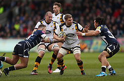 Wasps' Thomas Young hands off Sale's TJ Ioane during the Aviva Premiership match at the AJ Bell Stadium, Sale.