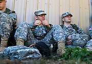 "October 2, 2010 - Fort Devens, MA - Freshman Army ROTC cadets Marcin Butkiewicz, center, and John Smoot, right, wait for instruction between tasks during the fall field training exercise at Fort Devens, Massachusett.  ""Hurry up and wait! That's the Army motto,"" said Butkiewicz, a 25-year-old cadet who recently returned from service in Iraq.  Butkiewicz, a Holbrook, Massachusetts native with dual United States and Polish citizenship, joined the army about three years ago after attending two different universities as a freshman and taking a year off to live with relatives in Poland. (Photo by Amy Donnelly, COM 2011)"