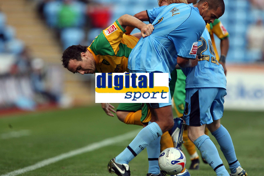 Photo: Rich Eaton.<br /> <br /> Coventry City v Norwich City. Coca Cola Championship. 09/09/2006. Lee Croft of Norwich left, and Marcus Hall of Coventry fight for the ball