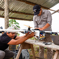 Martín Pillaca, GIS Specialist at CINCIA, (left) helps prepare the fixed wing drone for its next mapping flight over La Pampa. Following Peru's February 2019 militarized crackdown on illegal and unofficial alluvial gold mining in the La Pampa region of Madre de Dios, Wake Forest University's Puerto Maldonado-based Centro de Innovación Científica Amazonia (CINCIA), a leading research institution for the development of technological innovation for biological conservation and environmental restoration in the Peruvian Amazon, is applying years of scientific research and technical experience related to understanding mercury contamination and managing Amazonian ecosystems. What they learn will help guide urgent remediation, restoration, and reforestation efforts that can also serve as models for how we address the tropic's most dramatically devastated landscapes around the world. La Pampa, Madre de Dios, Peru.