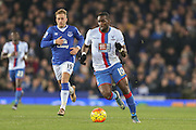 Crystal Palace midfielder Yannick Bolasie  chased by Everton forward Gerard Deulofeu  during the Barclays Premier League match between Everton and Crystal Palace at Goodison Park, Liverpool, England on 7 December 2015. Photo by Simon Davies.