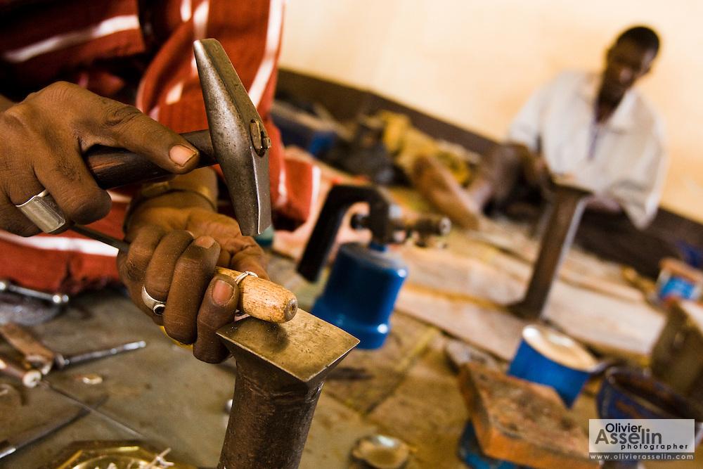 Man making silver jewelry at the Village Artisanal de Ouagadougou, a cooperative that employs dozens of artisans who work in different mediums, in Ouagadougou, Burkina Faso, on Monday November 3, 2008.