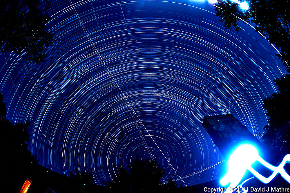 Evening/night star trails looking north. Autumn night sky in New Jersey. Composite of 190 images taken with a Nikon D3 camera and 16 mm f/2.8 fisheye lens (ISO 400, 16 mm, f/4, 59 sec).