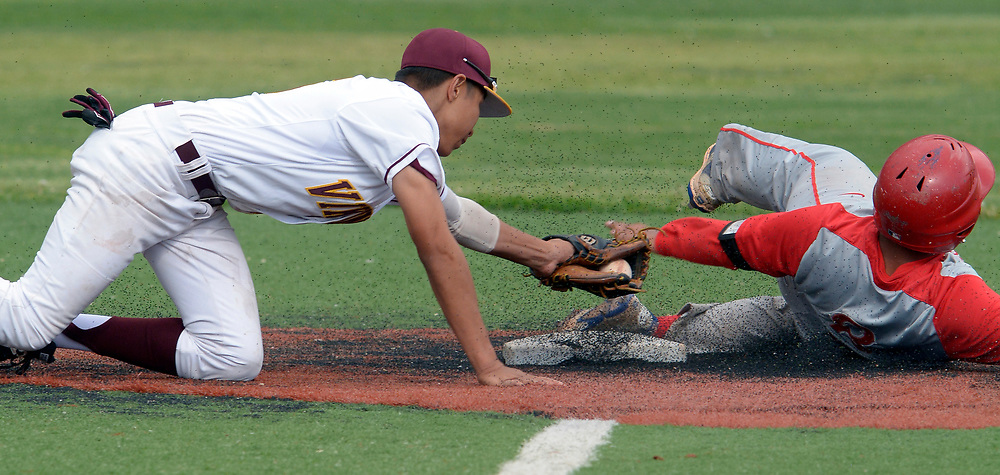 gbs042517n/SPORTS -- Valley  second baseman Julian Garcia is late on the tag of West Mesa's Angel Hernandez in the 4th inning of the game at Valley on Tuesday, April 25, 2017.  (Greg Sorber/Albuquerque Journal)