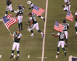 Sept 11, 2011; East Rutherford, NJ, USA;  New York Jets quarterback Mark Sanchez (6) waves an American flag before the first half at the MetLife Stadium.