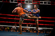 Phatsorn Bunmasen, 14, is exchanging hip kicks with her opponent during a Muay Thai boxing match organised in a village near Ubon Ratchathani, northeast Thailand.