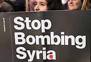 UNITED KINGDOM, London: 16 April 2018 Protesters stand with placard at a Stop The War Coalition demonstration on Parliament Square this evening. The demonstration, held outside of the Houses of Parliament, was to protest against military intervention in Syria. Rick Findler / Story Picture Agency