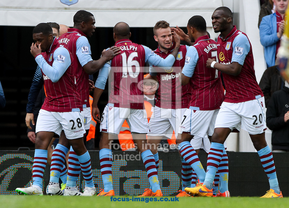 Tom Cleverley (3rd right) of Aston Villa celebrates scoring his sides first goal with his team mates during the Barclays Premier League match at Villa Park, Birmingham<br /> Picture by Tom Smith/Focus Images Ltd 07545141164<br /> 09/05/2015