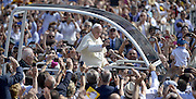 &copy; Filippo Alfero<br /> Papa Francesco in visita a Torino<br /> Torino, 21/06/2015<br /> Nella foto: Papa Francesco sulla papamobile passa tra la folla in Piazza Vittorio