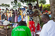 Women from Kitahurira, the only Batwa tribe settlement in Mpungu district, wait with their children to attend the Bwindi Community Hospital outreach clinic. The mothers and children receive nutrition information and vaccinations from the hospital nurse.  Bwindi Community Hospital provides different outreach clinics everyday for the surrounding area around Buhoma. The Mpungu district is on the edge of the Bwindi Impenetrable Forest, Western Uganda.