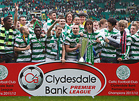 Football - Scottish Premier League -  Celtic vs. Hearts <br /> <br /> Celtic players celebrate as captain Scott Brown lifts the Scottish Premier League trophy after the final league match against Hearts at Celtic Park, Glasgow on May 13th 2012.<br /> <br /> Colorsport