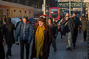 Commuters, including a woman in a Christmas pudding hat, walking through London on a winter morning. London, United Kingdom. <br /> (photo by Andrew Aitchison / In pictures via Getty Images)
