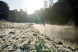 ©  London News Pictures. 08/10/2012. Marykirk, UK. A man fishing for salmon in the early morning on a mist covered River North Esk with the river bank covered in frost, near Marykirk, Aberdeenshire, Scotland on October 8, 2012. Photo credit : Ben Cawthra/LNP