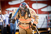 A firefighter drags a firehose while wearing full firefighting gear and working against the clock during the international finals of the Firefighter Combat Challenge on November 18, 2011 in Myrtle Beach, South Carolina.