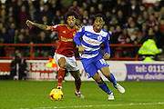 Nottingham Forest midfielder Ryan Mendes and QPR midfielder Leroy Fer challenge for the ball during the Sky Bet Championship match between Nottingham Forest and Queens Park Rangers at the City Ground, Nottingham, England on 26 January 2016. Photo by Aaron Lupton.