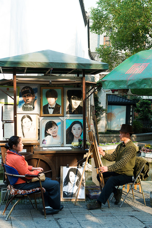 A street artist doing a portrait drawing