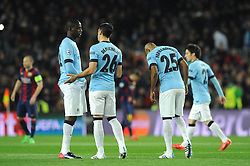 Manchester City's Martin Demichelis has words with \Manchester City's Yaya Toure - Photo mandatory by-line: Dougie Allward/JMP - Mobile: 07966 386802 - 18/03/2015 - SPORT - Football - Barcelona - Nou Camp - Barcelona v Manchester City - UEFA Champions League - Round 16 - Second Leg