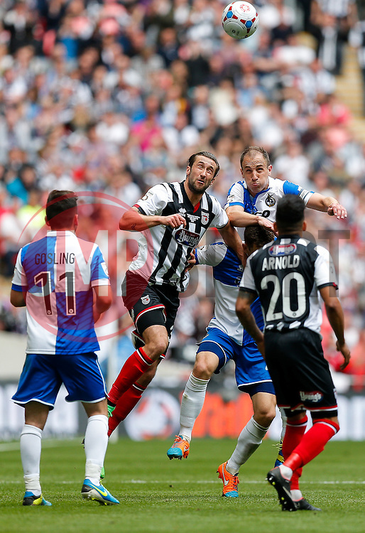 Ollie Palmer of Grimsby Town and Mark McChrystal of Bristol Rovers compete in the air - Photo mandatory by-line: Rogan Thomson/JMP - 07966 386802 - 17/05/2015 - SPORT - FOOTBALL - London, England - Wembley Stadium - Bristol Rovers v Frimsby Town - Vanarama Conference Premier Play-off Final.
