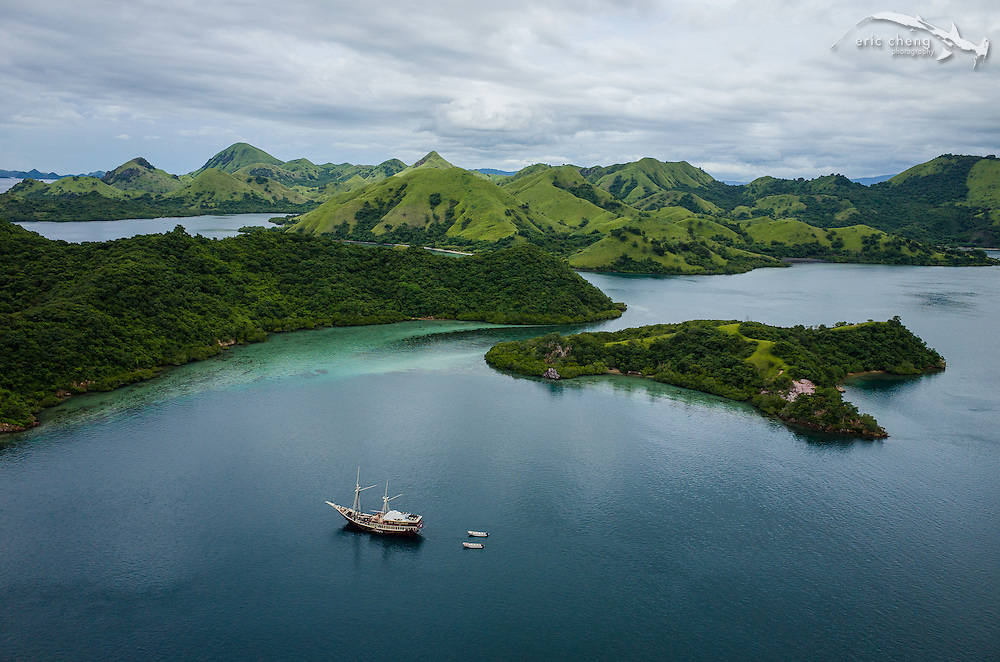 Aerial view of the liveaboard dive vessel, M/V Seven Seas, near the channel between Pulau Nisapurung and Boasala. Komodo National Park, Indonesia.