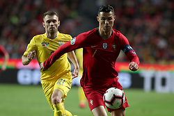 March 22, 2019 - Lisbon, Portugal - Portugal's forward Cristiano Ronaldo vies with Ukraine's defender Oleksandr Karavaev during the UEFA EURO 2020 group B qualifying football match Portugal vs Ukraine, at the Luz Stadium in Lisbon, Portugal, on March 22, 2019. (Credit Image: © Pedro Fiuza/ZUMA Wire)