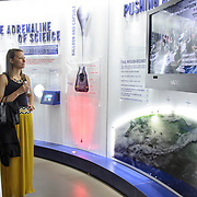 Attendees examine the items on display at the Red Bull Stratos Exhibit, held at The Smithsonian National Air and Space Museum in Washington, D.C., USA on 1 April, 2014.