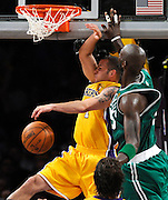 Jordan Farmar dunks the ball against Kevin Garnett in the 1st half. The Lakers defeated the Boston Celtics in game 6 of the NBA Finals 89-67. Los Angeles, CA 06/15/2010 (John McCoy/Staff Photographer).