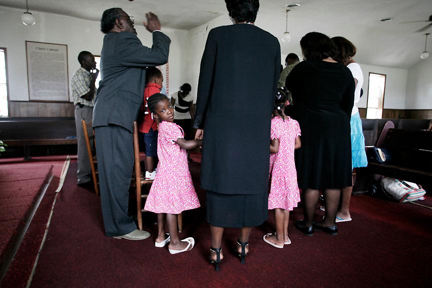 Prayer circle, St. Paul Missionary Baptist Church, Jonestown, Miss., 2007. <br /> Photo by D.L. Anderson