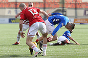 Hamilton Accademical defender Alex Gogic (13) and Rangers midfielder Ryan Kent (14) battle for the ball during the Ladbrokes Scottish Premiership match between Hamilton Academical FC and Rangers at New Douglas Park, Hamilton, Scotland on 24 February 2019.