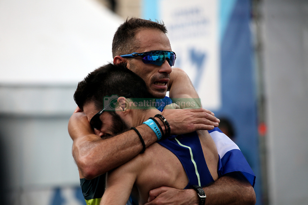 November 12, 2017 - Athens, Attica, Greece - Greek runners hug at the finish line at the 35th Athens Classic Marathon in Athens, Greece, November 12, 2017. (Credit Image: © Giorgos Georgiou/NurPhoto via ZUMA Press)
