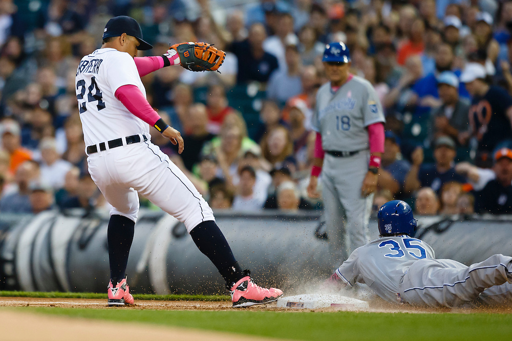 May 10, 2015; Detroit, MI, USA; Kansas City Royals first baseman Eric Hosmer (35) is out diving into first as Detroit Tigers first baseman Miguel Cabrera (24) tags the base in the first inning at Comerica Park. Mandatory Credit: Rick Osentoski-USA TODAY Sports
