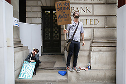 © Licensed to London News Pictures. 20/06/2015. London, UK. Demonstrators take part in an End Austerity Now protest, which starts outside Bank of England in London on Saturday, June 20, 2015. Activists are demonstrating against the current Conservative government and planned spending cuts. Photo credit: Tolga Akmen/LNP