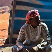 This was Ali a Bedouin we met in the desert of Wadi Rum Jordan and very friendly he invited us to drink hot tea.