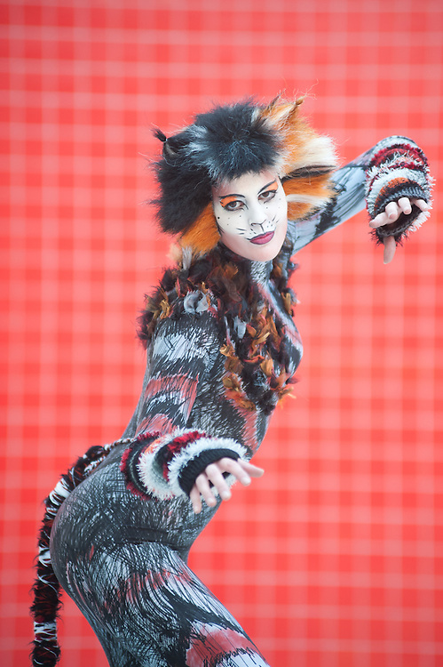 London, UK - 26 May 2013: Emily Clapp dressed as electra from Cats poses for a picture during the London Comic Con 2013 at Excel London. London Comic Con is the UK's largest event dedicated to pop culture attracting thousands of artists, celebrities and fans of comic books, animes and movie memorabilia.