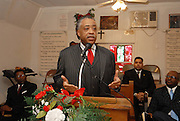 Rev.Sharpton gestures as he speaks during Sunday services at the Antioch Baptist Church in Jena Louisiana Jan. 20, 2008. The town of Jena Louisiana rescheduled their Martin Luther King Holiday festivities from Monday to Sunday because the Nationalist Movement planned a march in Jena on MLK day. Reverand Al Sharpton speaks Sunday Jan. 20,2008 at the Antioch Baptist Church in Jena Louisiana. Sharpton came to Jena the day before Martin Luther King holiday because the Nationalist Movement lead by Richard Barrett is to march on Jena Monday during MLK holiday. The Nationalist movement is coming to Jena in response to the Jena 6 rally last year. Sharpton was in Jena to protest the Jim Crow Justice still prevalent in the south. Sharpton discussed his feeling about MLK's legacy and how it should be celebrated and that their are still, today in the South many things to fight for, Equal Justice would be at the top of his list. Sharpton said you can not heal the community until justice is dealt with fairly, no white justice or black  justice -Equal Justice for all is what will heal the town of Jena.(Photo/© Suzi Altman)