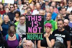 "© Licensed to London News Pictures. 31/08/2019. Manchester, UK. A placard reading "" This is not normal "" .Thousands attend a pro EU demo in Albert Square Manchester City Centre , with objections raised to the Prime Minister Boris Johnson's intention to prorogue Parliament in the run up to Britain's planned Brexit deadline . Photo credit: Joel Goodman/LNP"