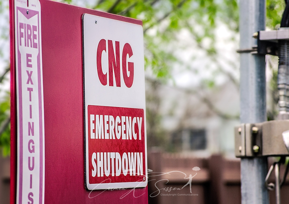 """A CNG (compressed natural gas) emergency shutdown sign is pictured at Waste Pro's time-fill station, March 19, 2016, in Jacksonville, Florida. Waste Pro offers waste and recycling services to more than two million residential customers and more than 40,000 businesses in Alabama, Florida, Georgia, South and North Carolina, Louisiana, Mississippi, and Tennessee. The company has committed to """"going green"""" by implementing a number of green initiatives, including using CNG (compressed natural gas) in its trucks, recycling more waste instead of sending it to landfills, and powering its regional headquarters throuh solar energy. (Photo by Carmen K. Sisson/Cloudybright)"""