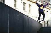 Mark Brewster doing a tail-slide on a concrete wall, London, UK, 2000's