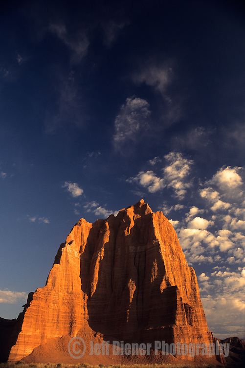 Sunrise hits the Temple Of The Sun rock formation in Capital Reef National Park, Utah.
