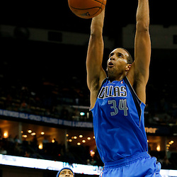 Apr 14, 2013; New Orleans, LA, USA; Dallas Mavericks center Brandan Wright (34) dunks against the New Orleans Hornets during the second half of a game at the New Orleans Arena. The Mavericks defeated the Hornets 107-89. Mandatory Credit: Derick E. Hingle-USA TODAY Sports
