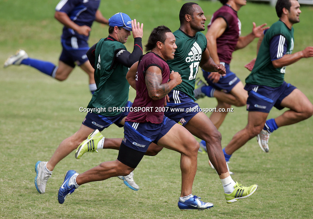 Anthony Tuitavake sprints against Joe Rokocoko at a Blues training session at Unitec, Auckland, New Zealand on Monday 26 March 2007. Photo :Hannah Johnston/PHOTOSPORT<br /><br /><br /><br />260307