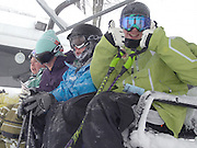 A happy unidentified skier gives a double thumbs up as he and his friends ride the lift to the top of Boyne Highlands Heather run after the resort officially opened its 2009/2010 ski season Saturday afternoon.