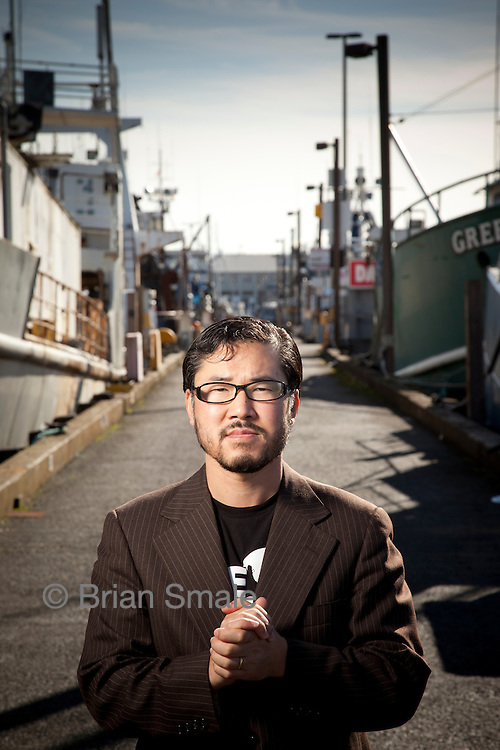 """Eugene Cho is the co-founder of """"One Day's Wages"""", a program to fight poverty by giving up one day's pay.  Cho is the founder and pastor at Quest Church in Seattle.  Photographed by Brian Smale for Christianity Today Magazine."""