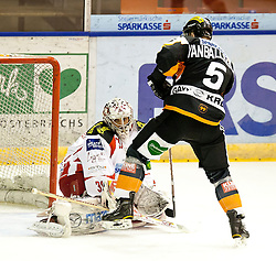 01.01.2012, Eisstadion Liebenau, Graz, AUT, EBEL, Moser Medical Graz 99ers vs EC KAC im Bild Dustin VanBallegooie (Moser Medical Graz 99ers, #5, Defender) und Andy Chiodo (EC KAC, #31, Goalkeeper) // during the Erste Bank Icehockey League, Eisstadion Liebenau, Graz, Austria, 2012-01-01, EXPA Pictures © 2012, PhotoCredit: EXPA/ Erwin Scheriau