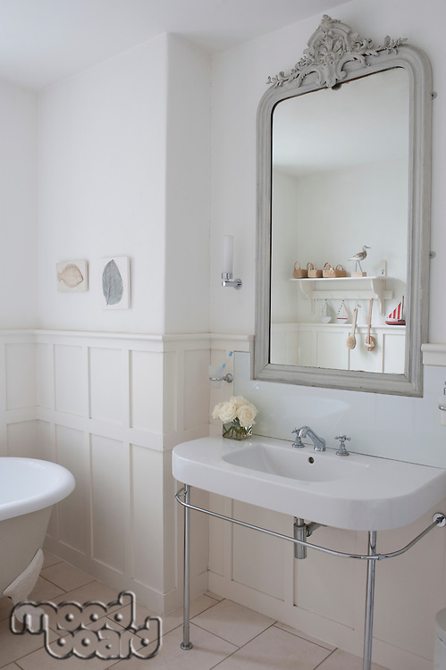 Grey painted mirror surround in panelled bathroom London