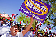 May 29 - PHOENIX, AZ: A man chants opposition to SB1070 in Phoenix Saturday. More than 30,000 people, supporters of immigrants' rights and opposed to Arizona SB1070, marched through central Phoenix to the Arizona State Capitol Saturday. SB1070 makes it an Arizona state crime to be in the US illegally and requires that immigrants carry papers with them at all times and present to law enforcement when asked to. Critics of the law say it will lead to racial profiling, harassment of Hispanics and usurps the federal role in immigration enforcement. Supporters of the law say it merely brings Arizona law into line with existing federal laws.  Photo by Jack Kurtz