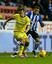 Joe Mattock of Sheffield Wednesday is challenged by James Tavernier of Wigan - Photo mandatory by-line: Rogan Thomson/JMP - 07966 386802 - 30/12/2014 - SPORT - FOOTBALL - Wigan, England - DW Stadium - Wigan Athletic v Sheffield Wednesday - Sky Bet Championship.