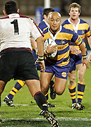 Bay of Plenty flanker Nili Latu looks to take on Harbour's Chris White during the Air New Zealand Cup week 3 rugby union match between Bay of Plenty and North Harbour at Blue Chip Stadium in Mt Maunganui, New Zealand on Saturday 12 August 2006. Photo: Andy Song/PHOTOSPORT
