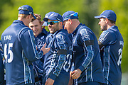 Scotland captain Kyle Coetzer (in sunglasses) is congratulated by his team mates after taking a catch to dismiss Hazratullah Zazai during the One Day International match between Scotland and Afghanistan at The Grange Cricket Club, Edinburgh, Scotland on 10 May 2019.